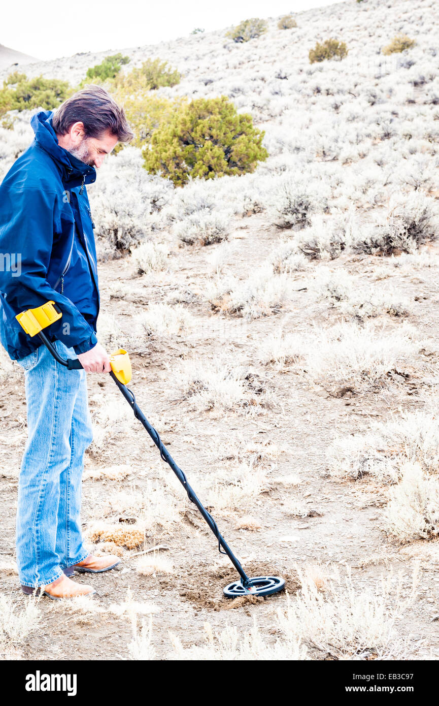 Man using metal detector in Black Rock desert, Nevada, America, USA Stock Photo