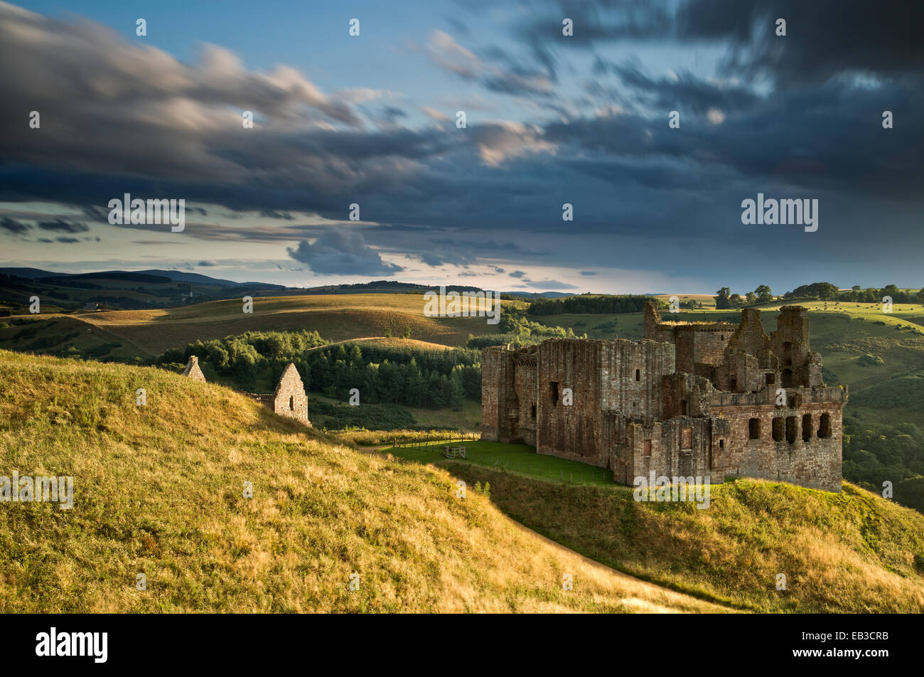 UK, Scotland, Midlothian, Pathhead, Ruins of Crichton Castle and surrounding landscape seen from hill covered in - Stock Image