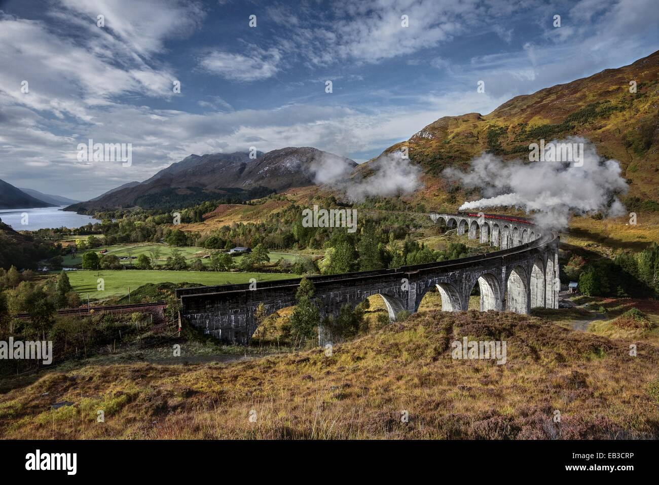 UK, Scotland, Elevated view of Jacobite Express crossing Glenfinnan Viaduct - Stock Image