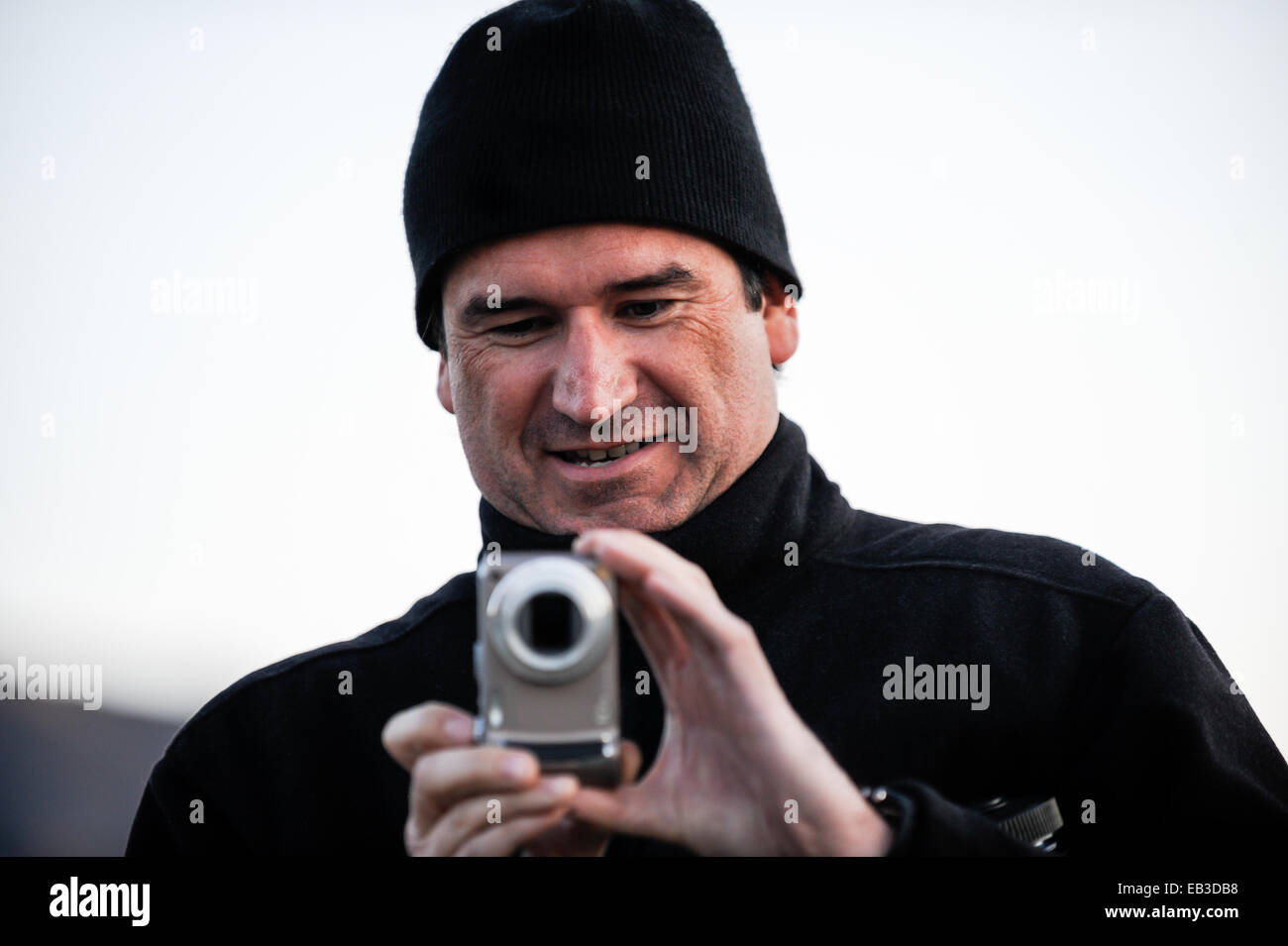 Portrait of a man taking a photo - Stock Image