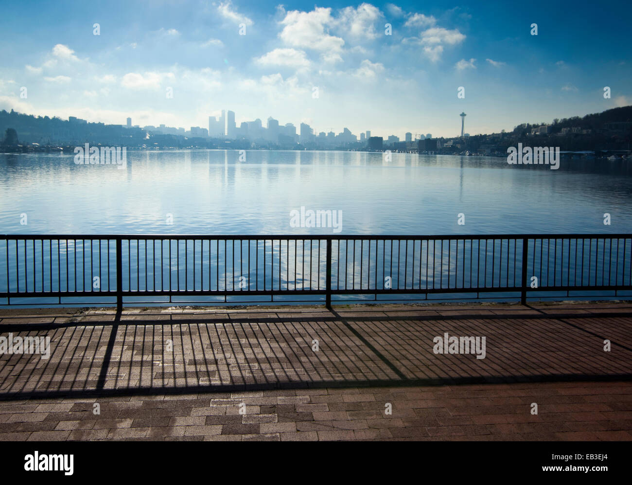 Banister overlooking Seattle city skyline from urban waterfront, Washington, United States - Stock Image
