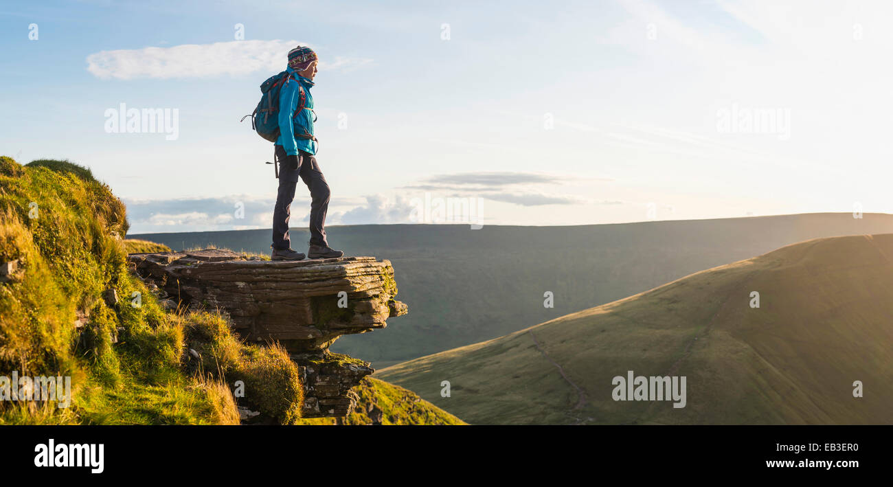 Panoramic view of hiker overlooking remote landscape - Stock Image
