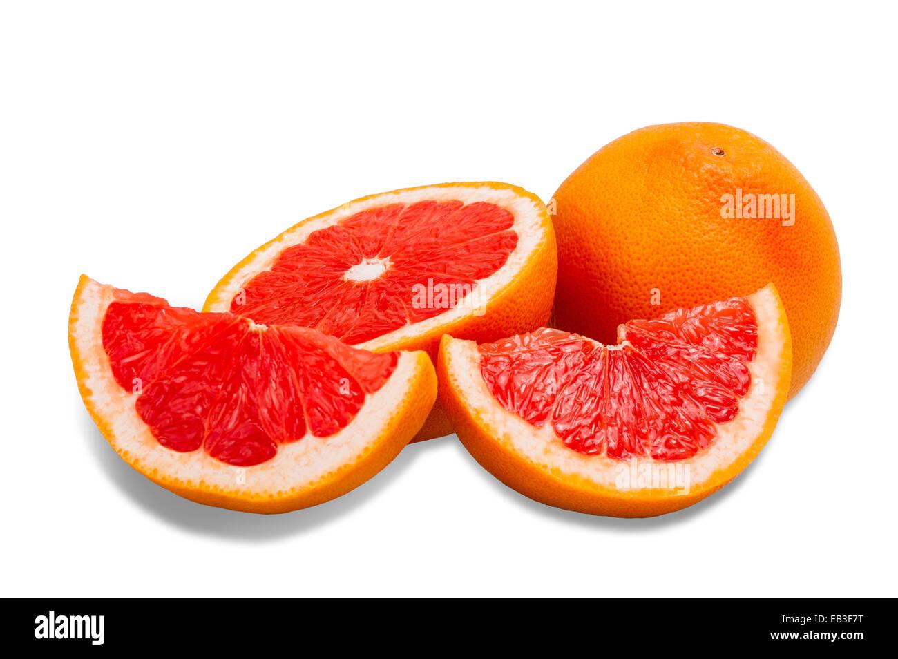 Ripe grapefruit sliced isolated on white background - Stock Image