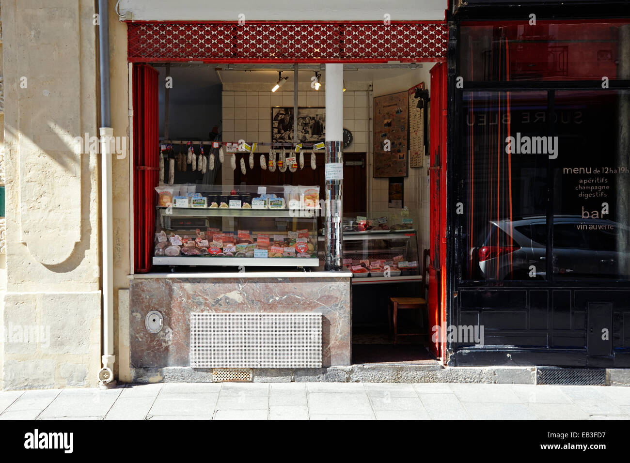 Paris food shop selling cooked meats - Stock Image