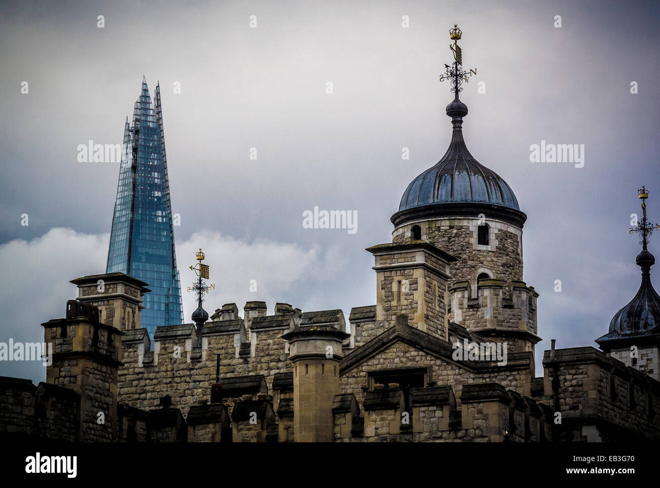 The Tower of London with The Shard building in the background. - Stock Image