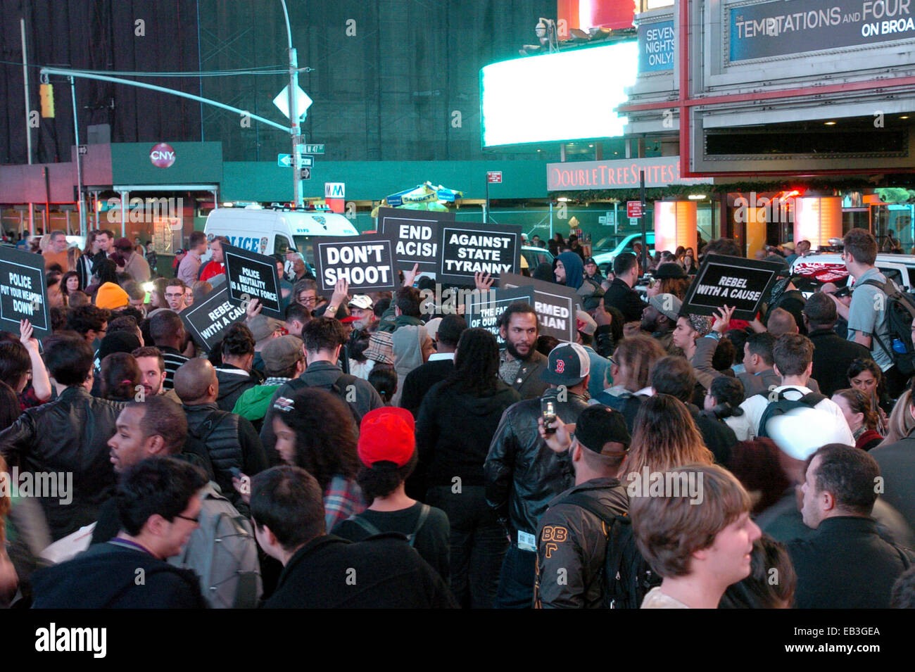 New York, USA. 24th Nov, 2014. Protesters march at Times Square in New York, the United States, on Nov. 24, 2014. A demonstration was held in New York after the announcement that police officer Darren Wilson would not be indicted for the shooting unarmed 18-year-old Michael Brown in Ferguson on August. © David Torres/Xinhua/Alamy Live News Stock Photo