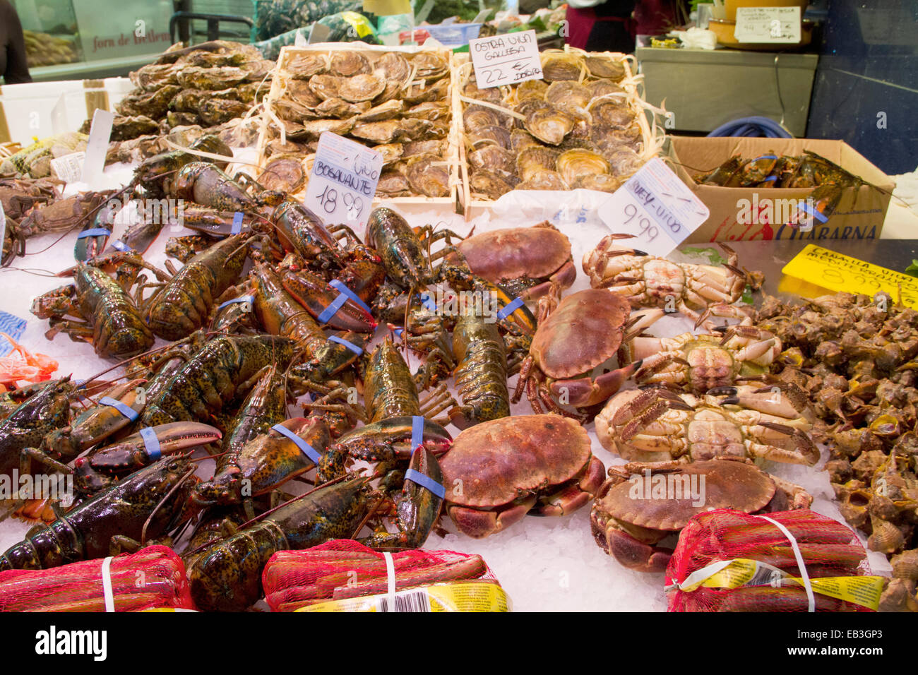 Stall displays fresh seafood including crabs and lobster for