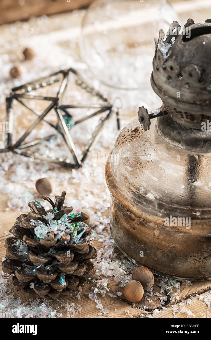 old-fashioned kerosene lamp,Christmas toys,pine cones - Stock Image