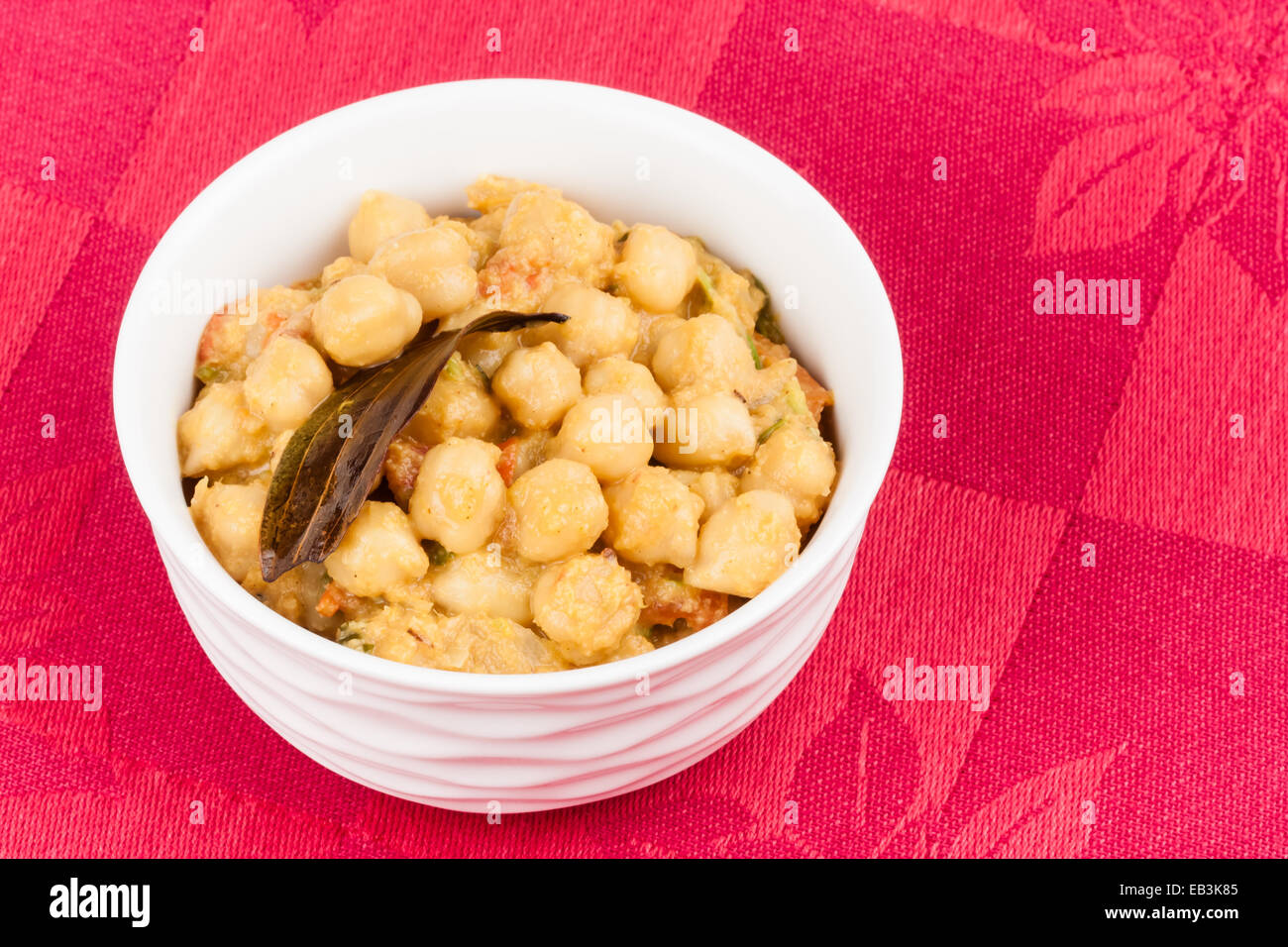 Closeup of delicious Indian chana masala. It is prepared using chana dal (chickpea) and various spices. - Stock Image