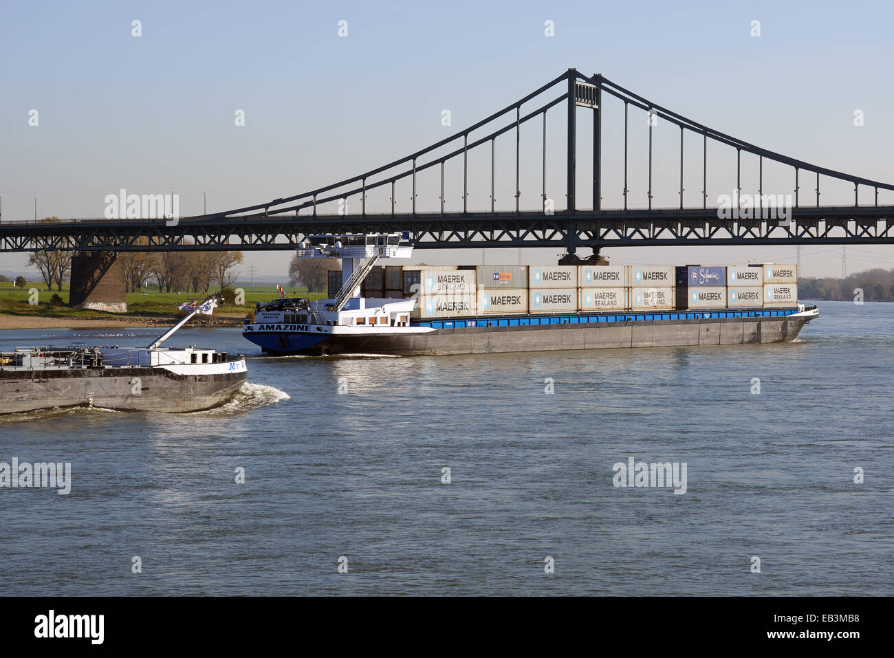 Amazon container barge, river Rhine, Krefeld, Germany. - Stock Image