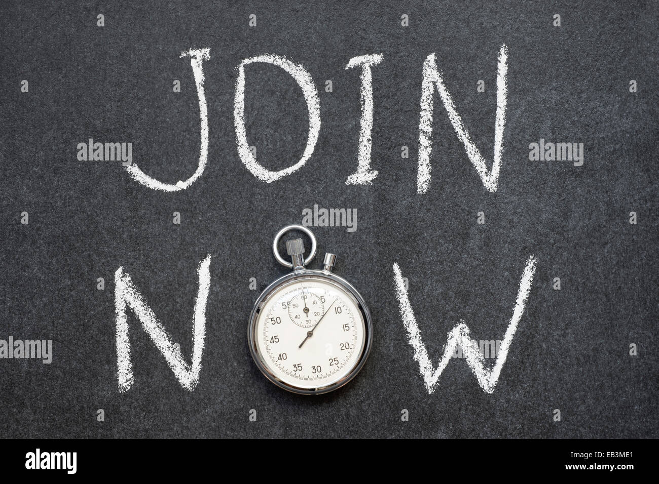 join now concept handwritten on chalkboard with vintage precise stopwatch used instead of O - Stock Image