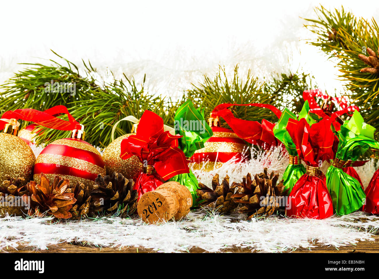 new year christmas tree background with pine cone christmas ball champagne corks and candies