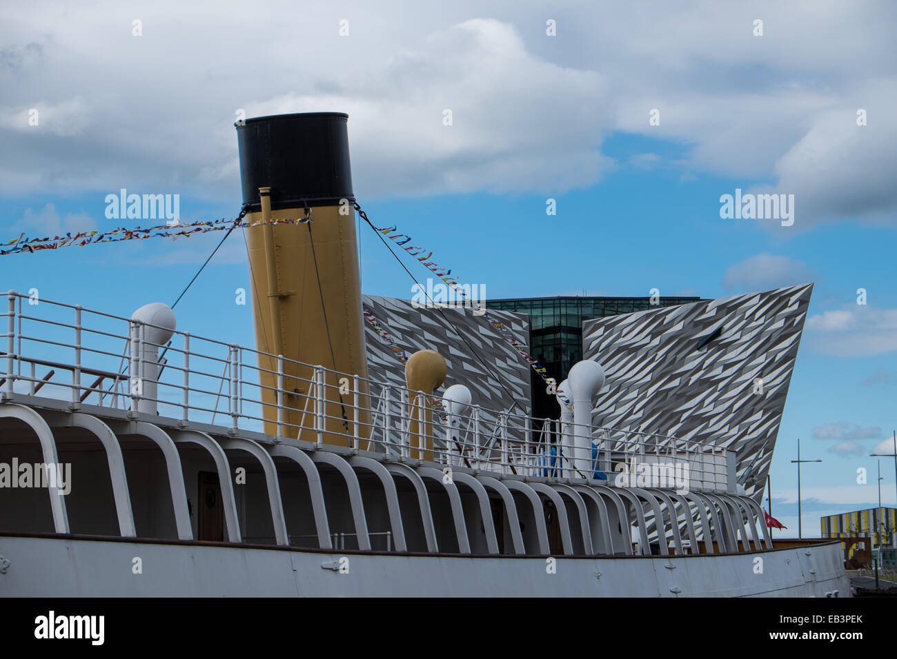 SS Nomadic steam ship in Belfast Northern Ireland built by Harland and Wolff with the Titanic museum in the background - Stock Image