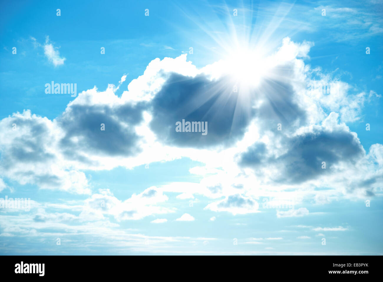 Beautiful blue sky with sunbeams and clouds. Sun rays. - Stock Image