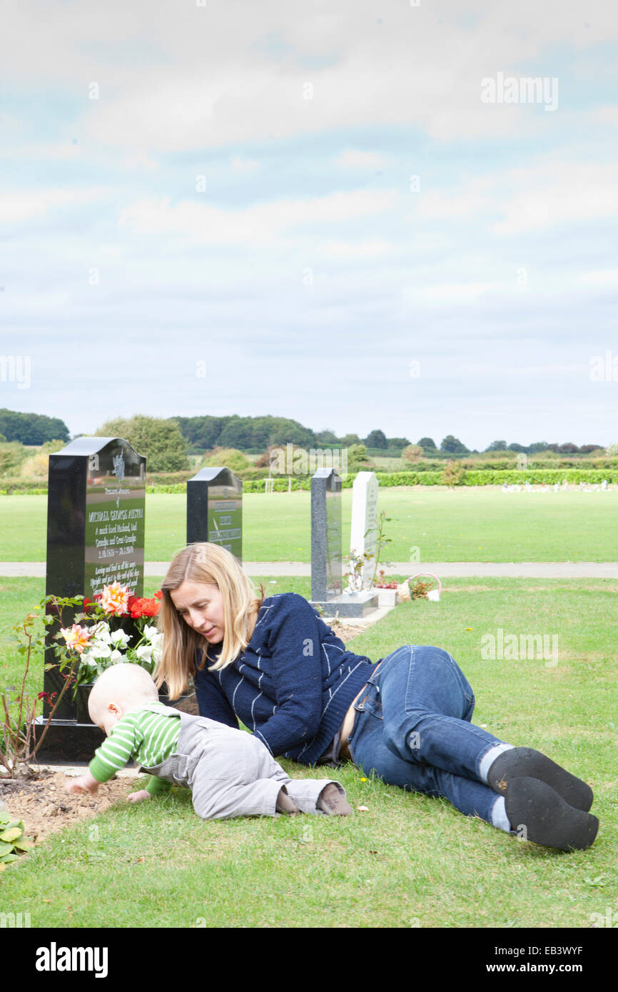 Mother and Baby at grave - Stock Image