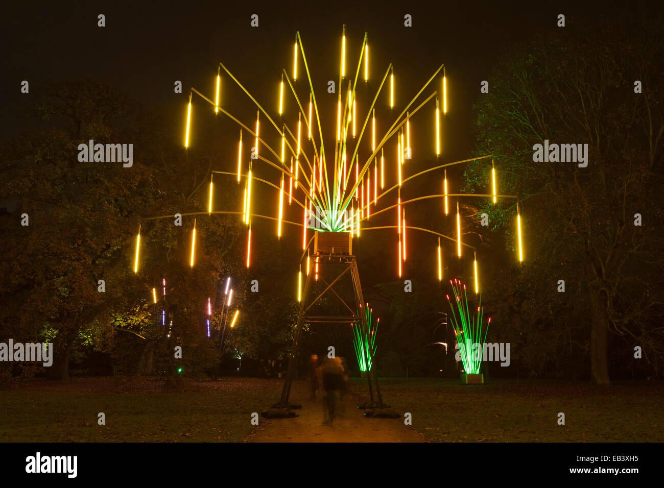 London UK. 25 November 2014. A light installation. Press preview of the seasonal illuminations lighting Kew Gardens after dark. & London UK. 25 November 2014. A light installation. Press preview of ...