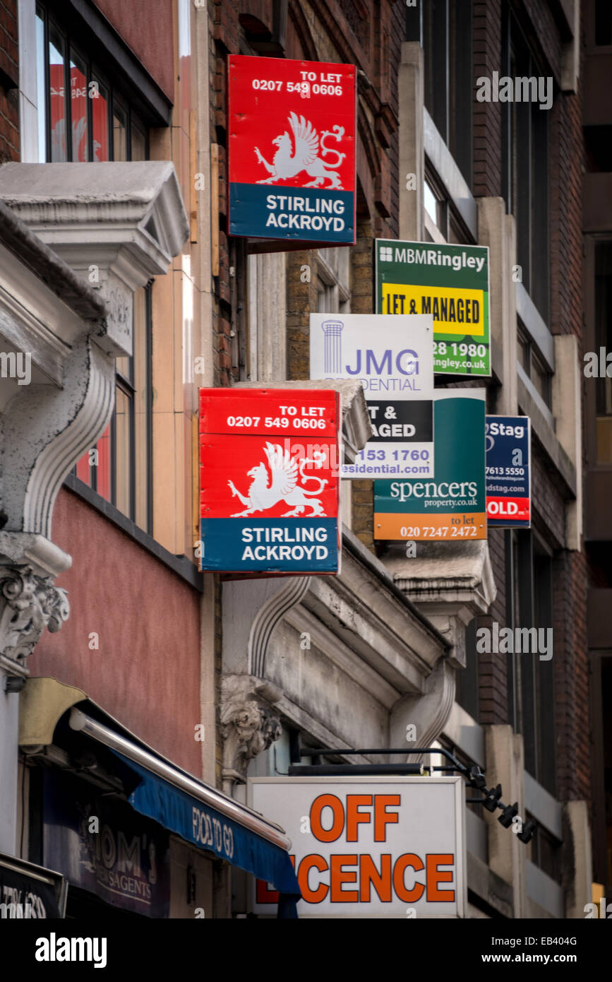 For Sale signs of various real estate agents in City Road, London - Stock Image