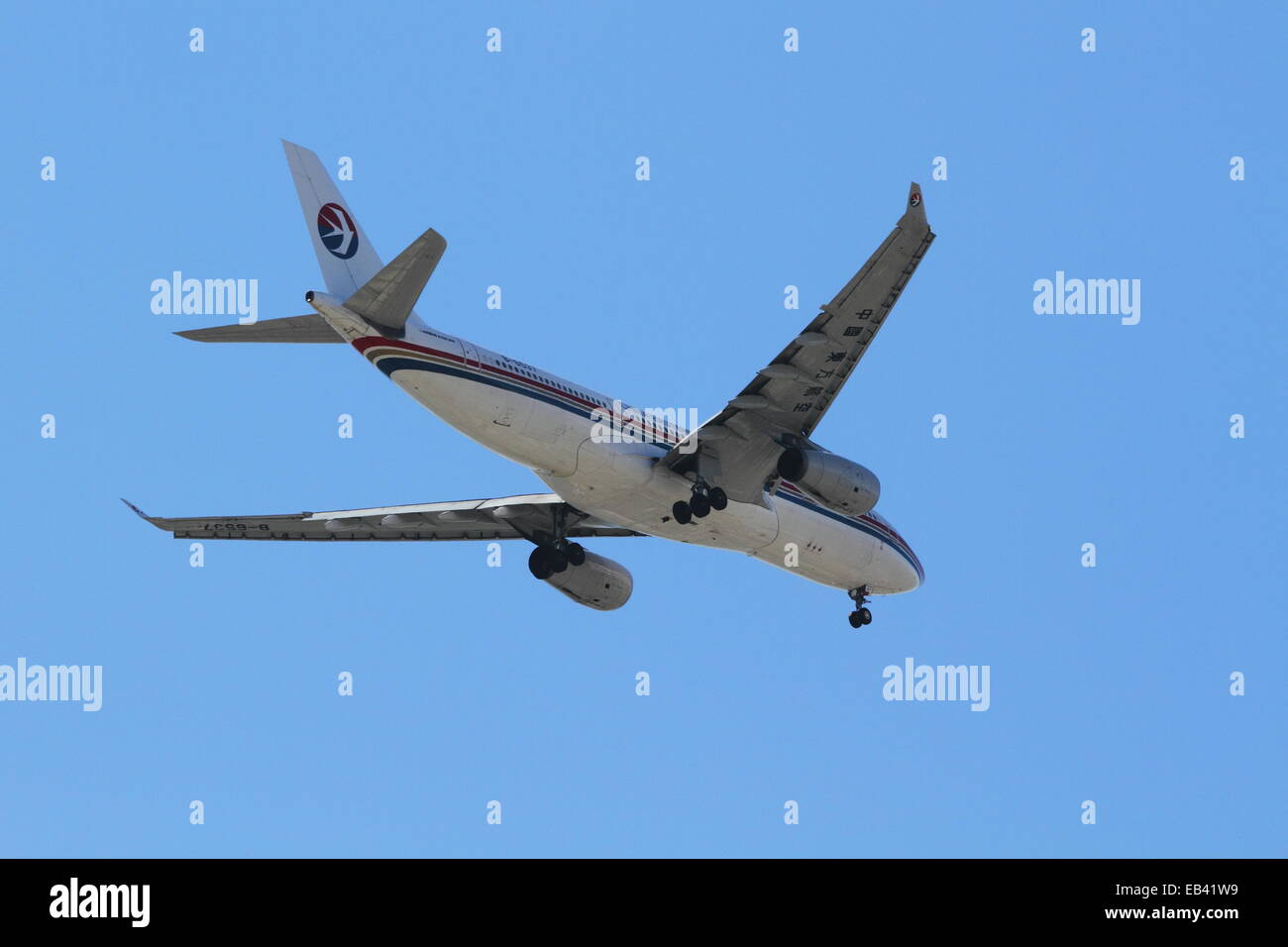 A China Eastern Airlines Airbus A330-200 registration B-6537 arriving at Sydney Airport, Sydney, Australia - Stock Image