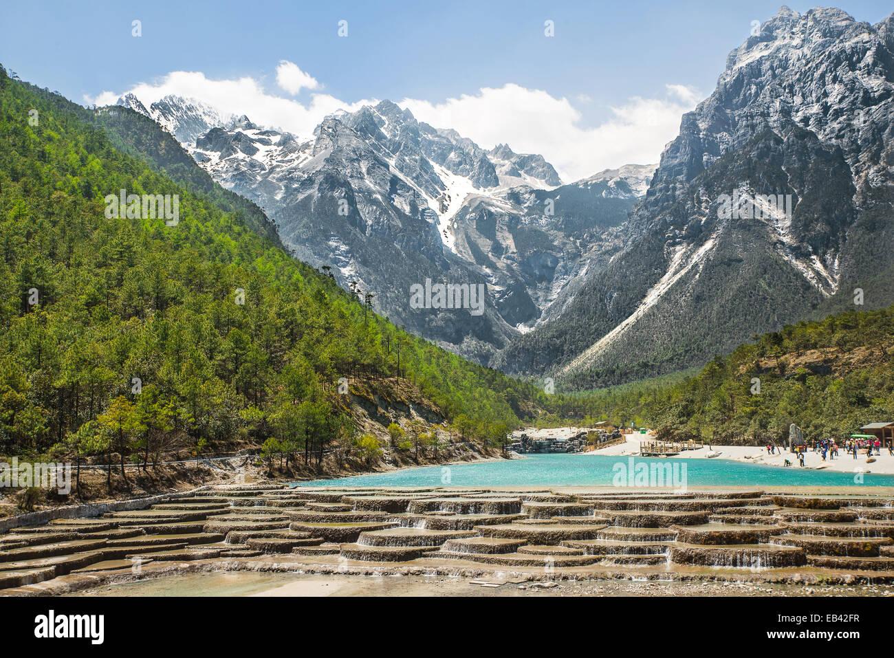 White Water River waterfall and Jade Dragon Snow Mountain, Lijiang, Yunnan China. Stock Photo