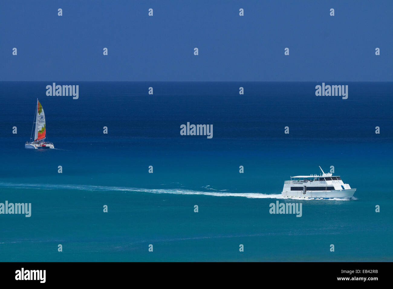 Catamaran and Atlantis tour boat, Waikiki, Honolulu, Oahu, Hawaii, USA - Stock Image