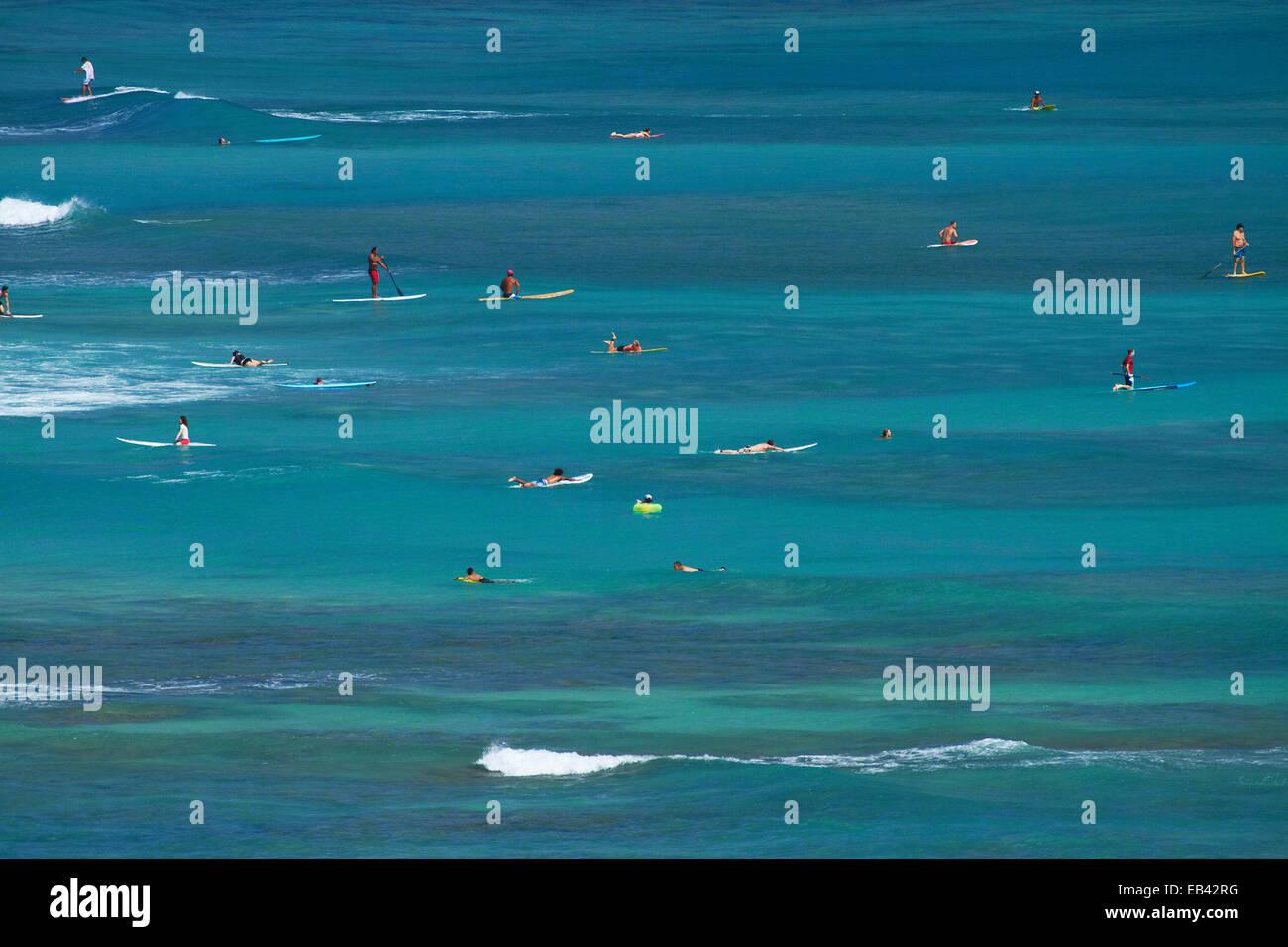Surfers and stand up paddle boarders, Waikiki, Honolulu, Oahu, Hawaii, USA - Stock Image