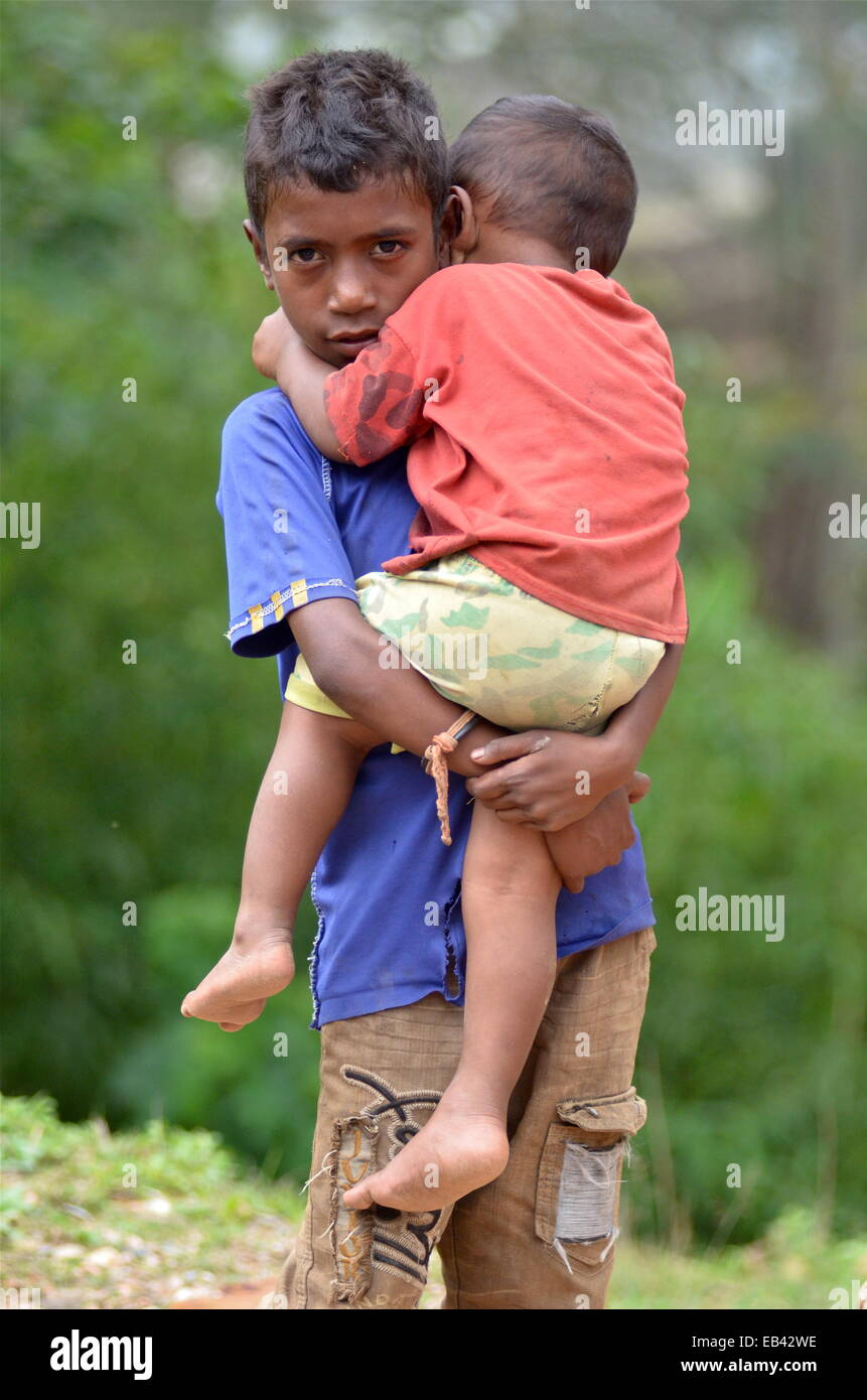 Young boy with his brother on the outskirts of Aileu, East Timor - Stock Image