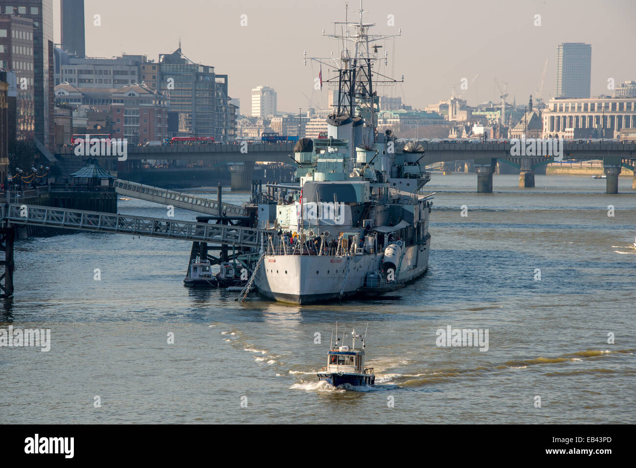 HMS Belfast on the banks of the River Thames, London. - Stock Image