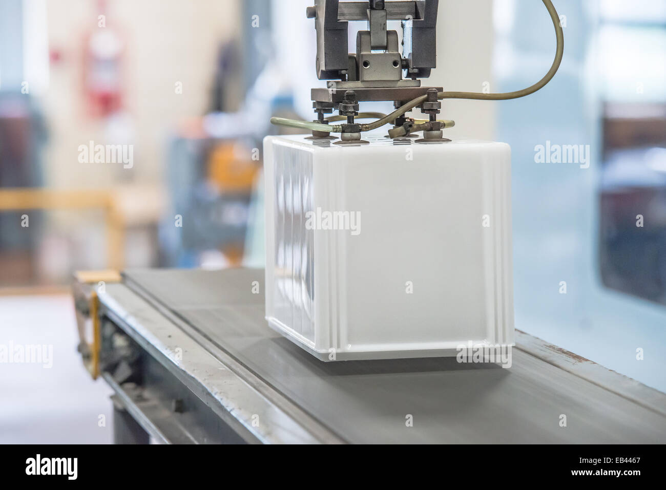 Industrial robot working in factory - Stock Image