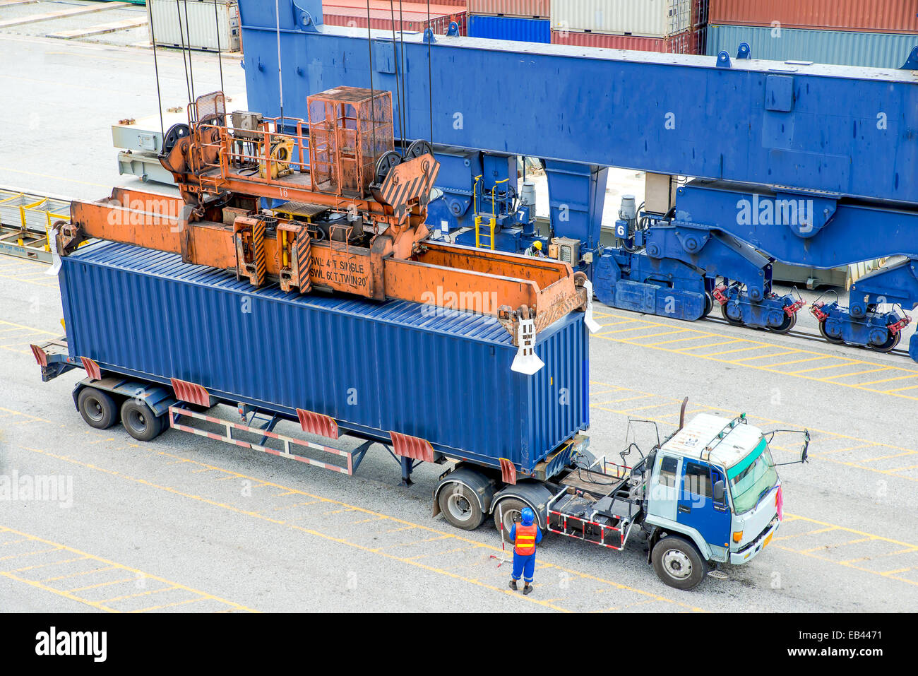 Container truck waiting for loading container box to Cargo ship - Stock Image