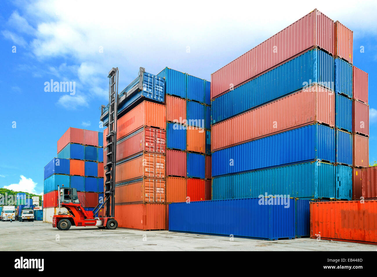 Crane lifter handling container box loading to depot - Stock Image