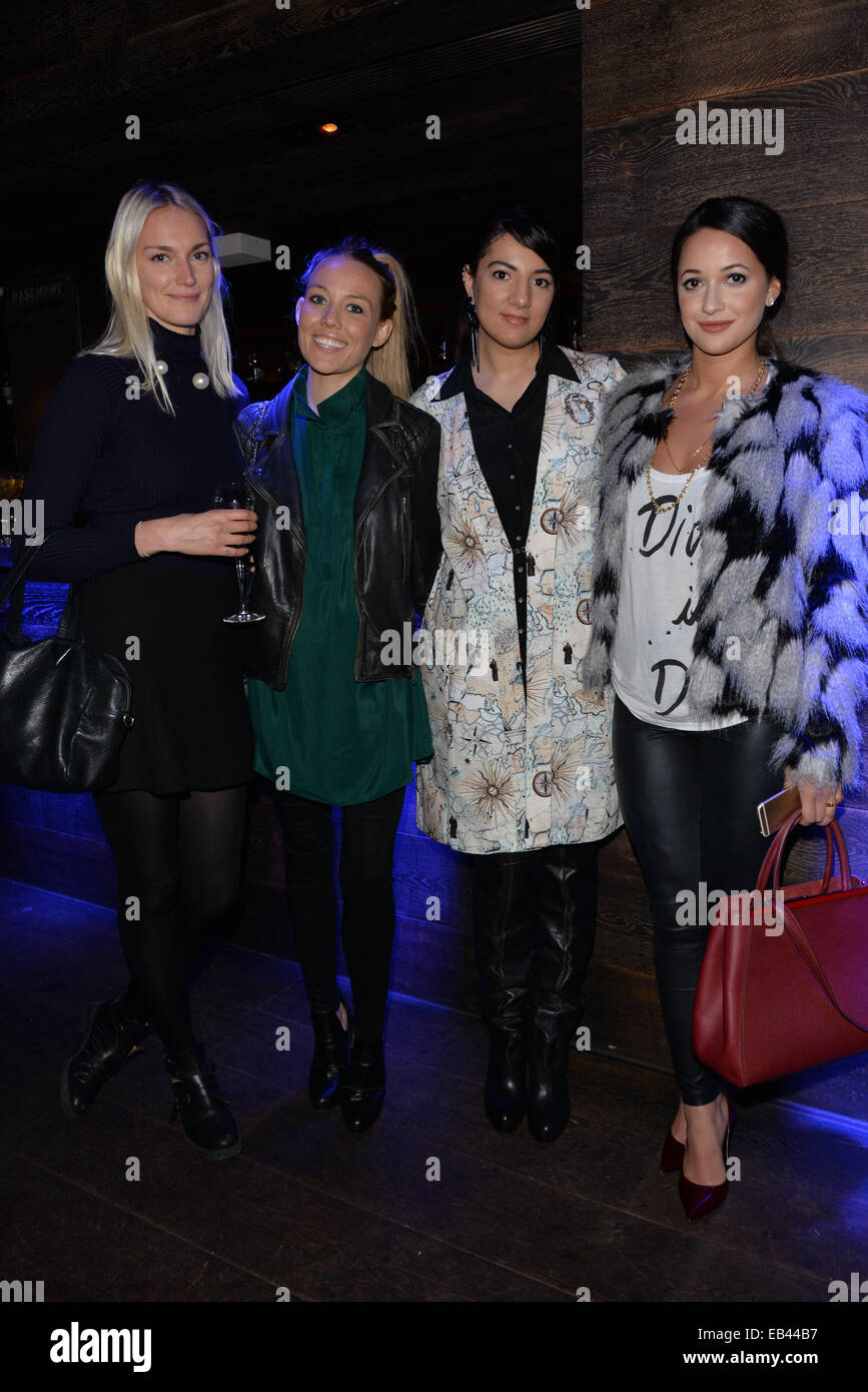 London, UK. 25th November 2014. Designer Gyunel (L3) and Roxie Nafousi (L4)attends the Gyunel pre-fall 2014 accessories - Stock Image