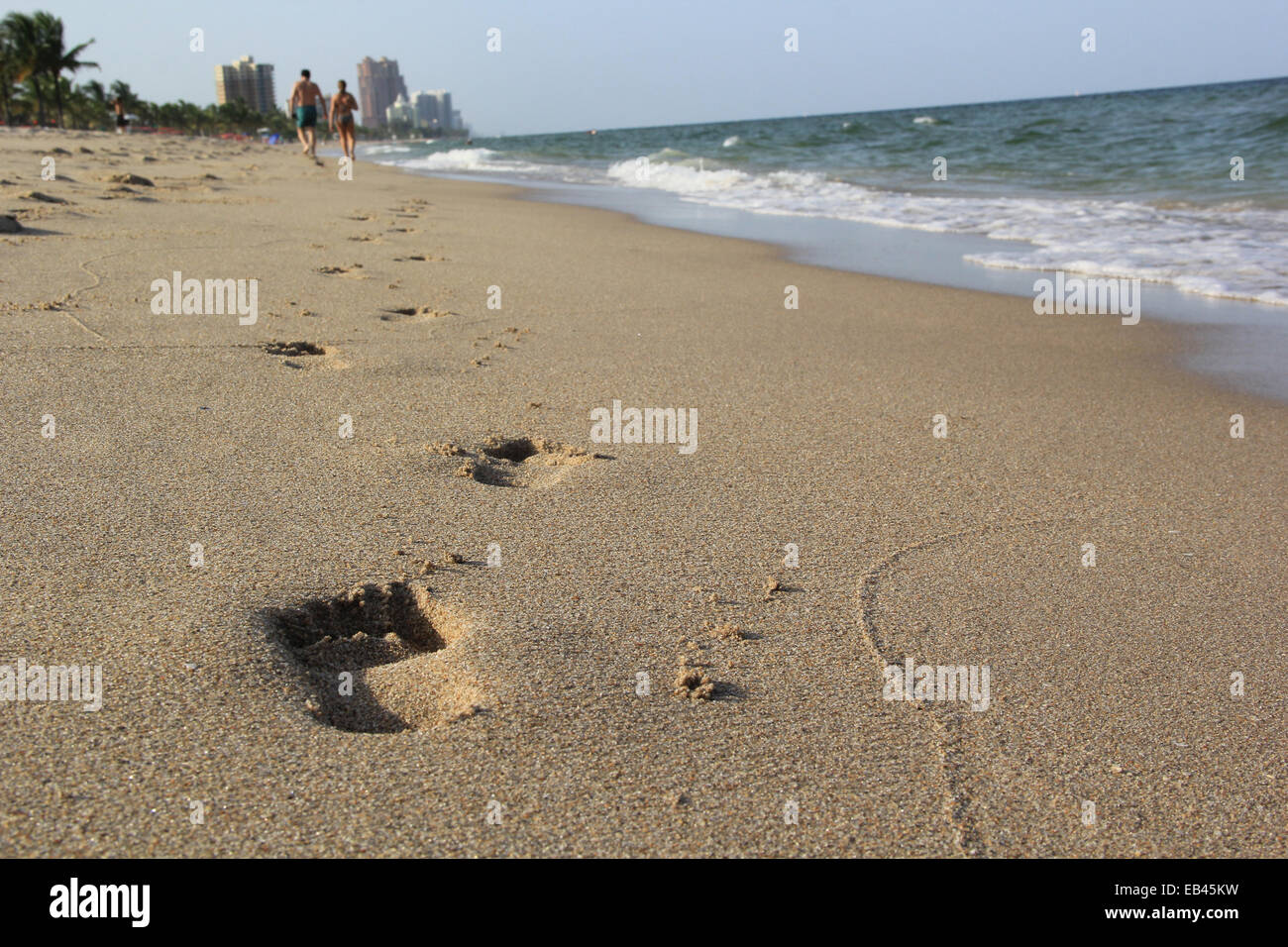 A couple walks in the beach, at Las Olas, Fort Lauderdale, Florida, United States. Stock Photo