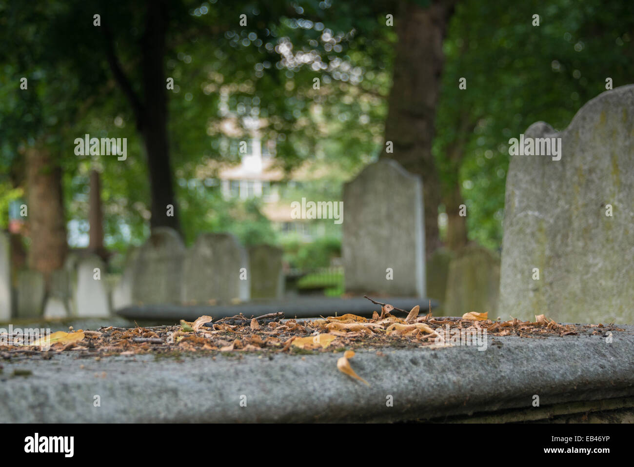 Bunhill Fields is an old burial ground in the London Borough of Islington, north of the City of London, and is a Stock Photo