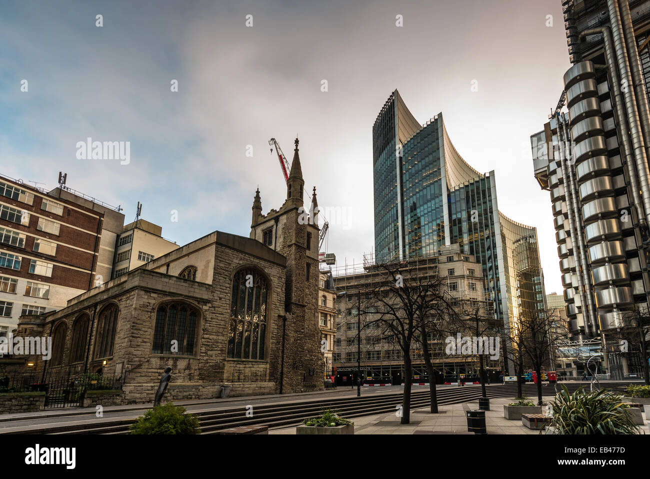 St Andrew Undershaft Church on St Mary Axe with the Willis Building and Lloyd's of London in the City of London - Stock Image
