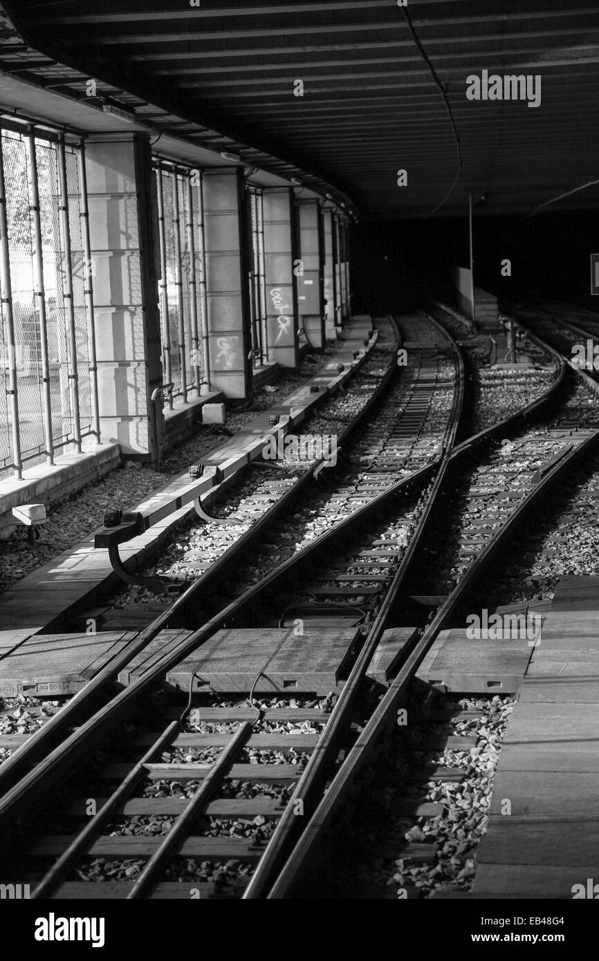 Train tracks in a Station. Photographed in Vienna Austria - Stock Image