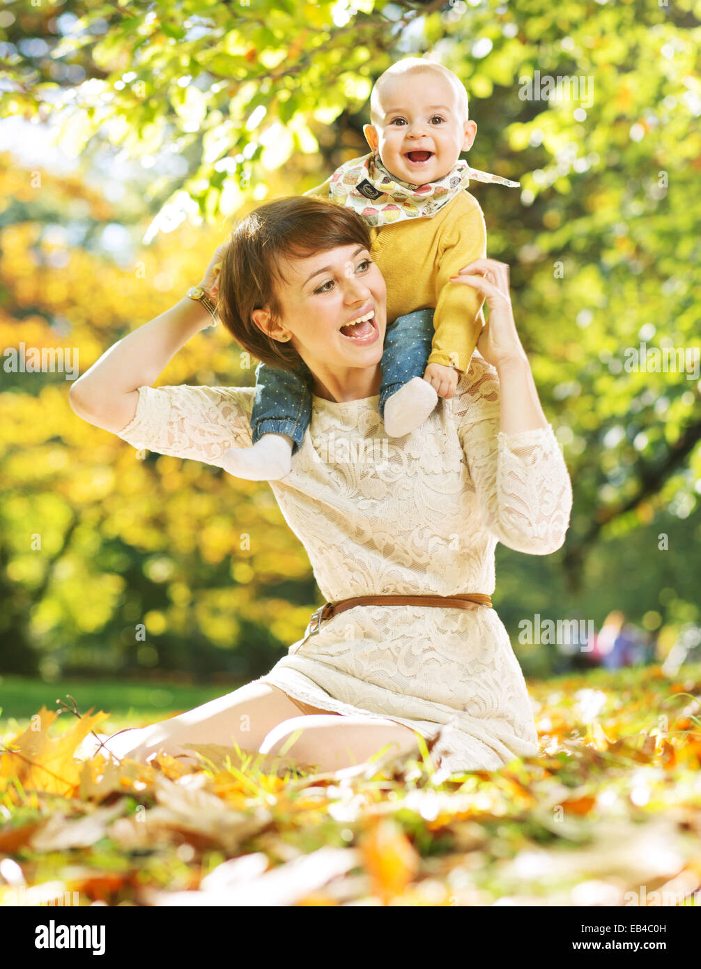 Laughing mother and cute daughter - Stock Image