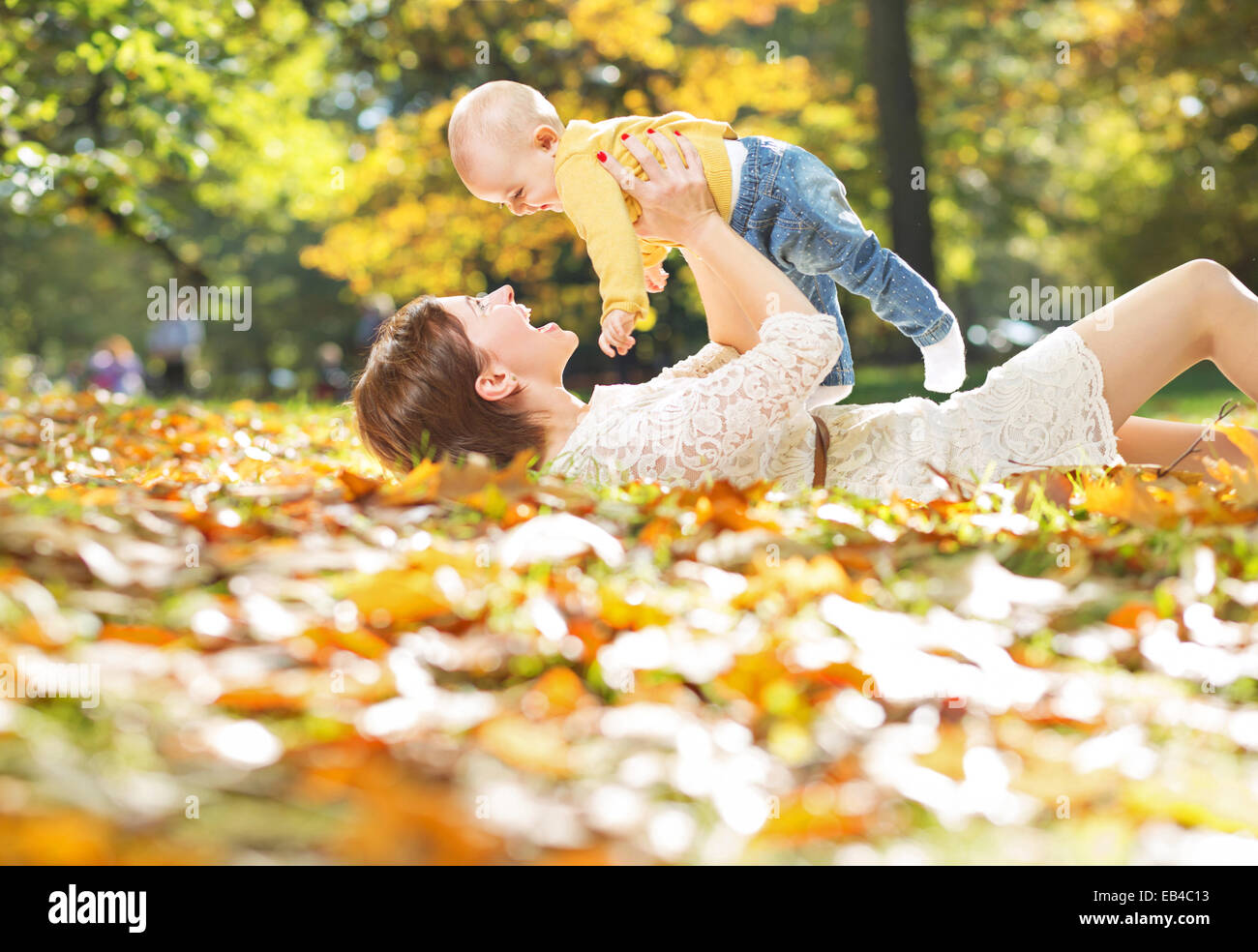 Autumn portrait of mother and baby - Stock Image