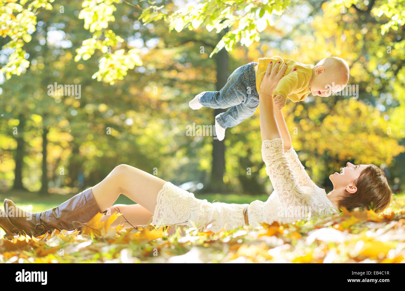 Young woman making her baby laughing - Stock Image