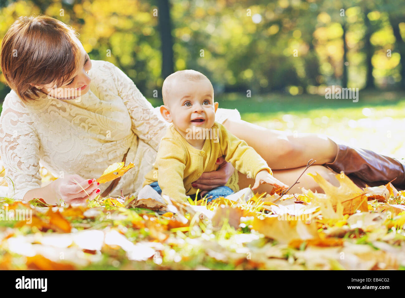 Charming mother looking after child - Stock Image
