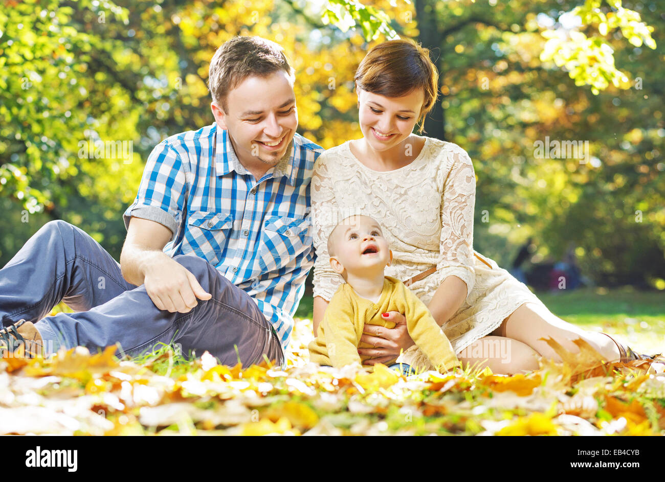 Glad parents observing their cute baby - Stock Image