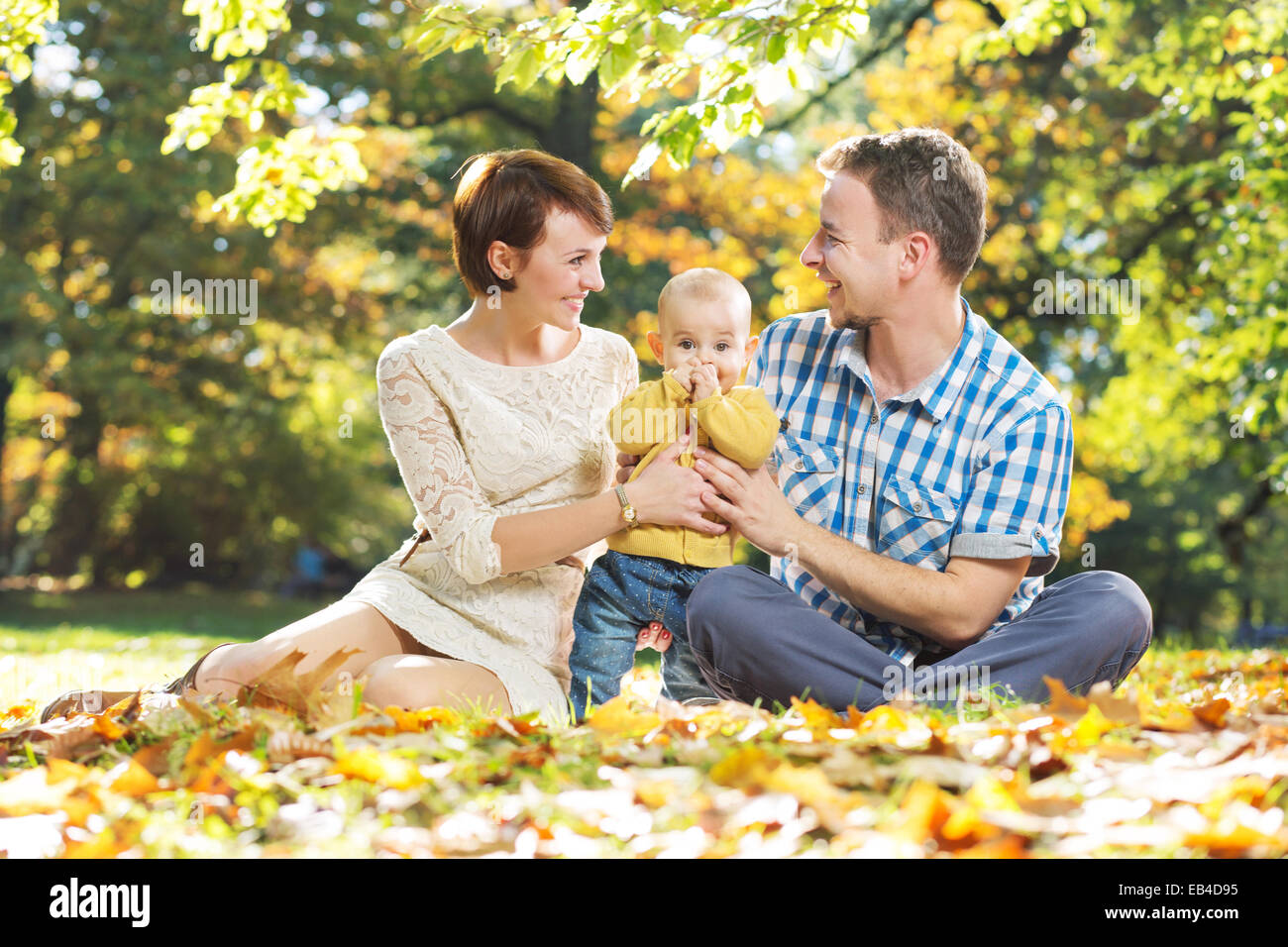 Portrait of parents with beloved baby - Stock Image