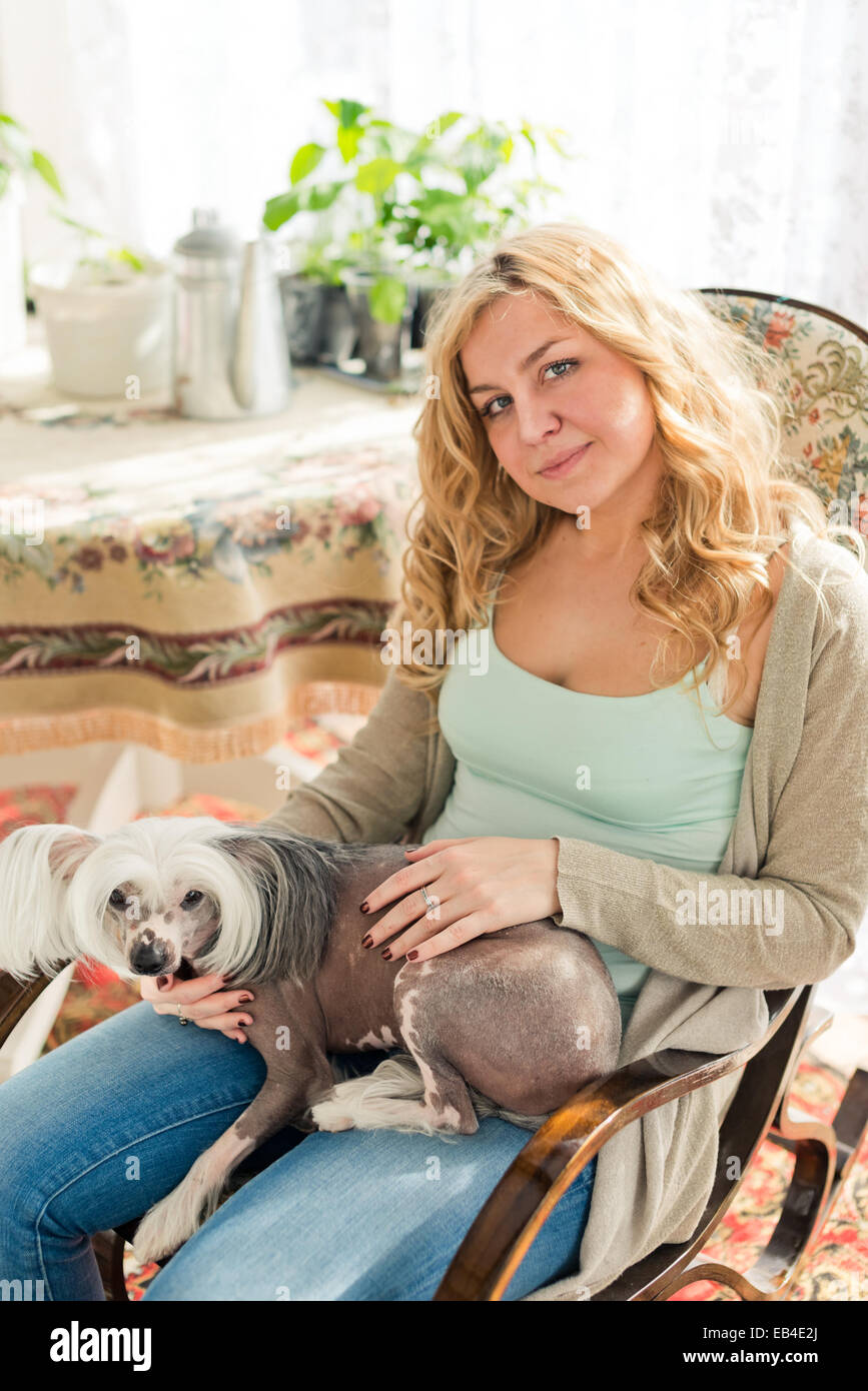Magnificent Blond Woman And Chinese Crested Dog In Rocking Chair Stock Frankydiablos Diy Chair Ideas Frankydiabloscom