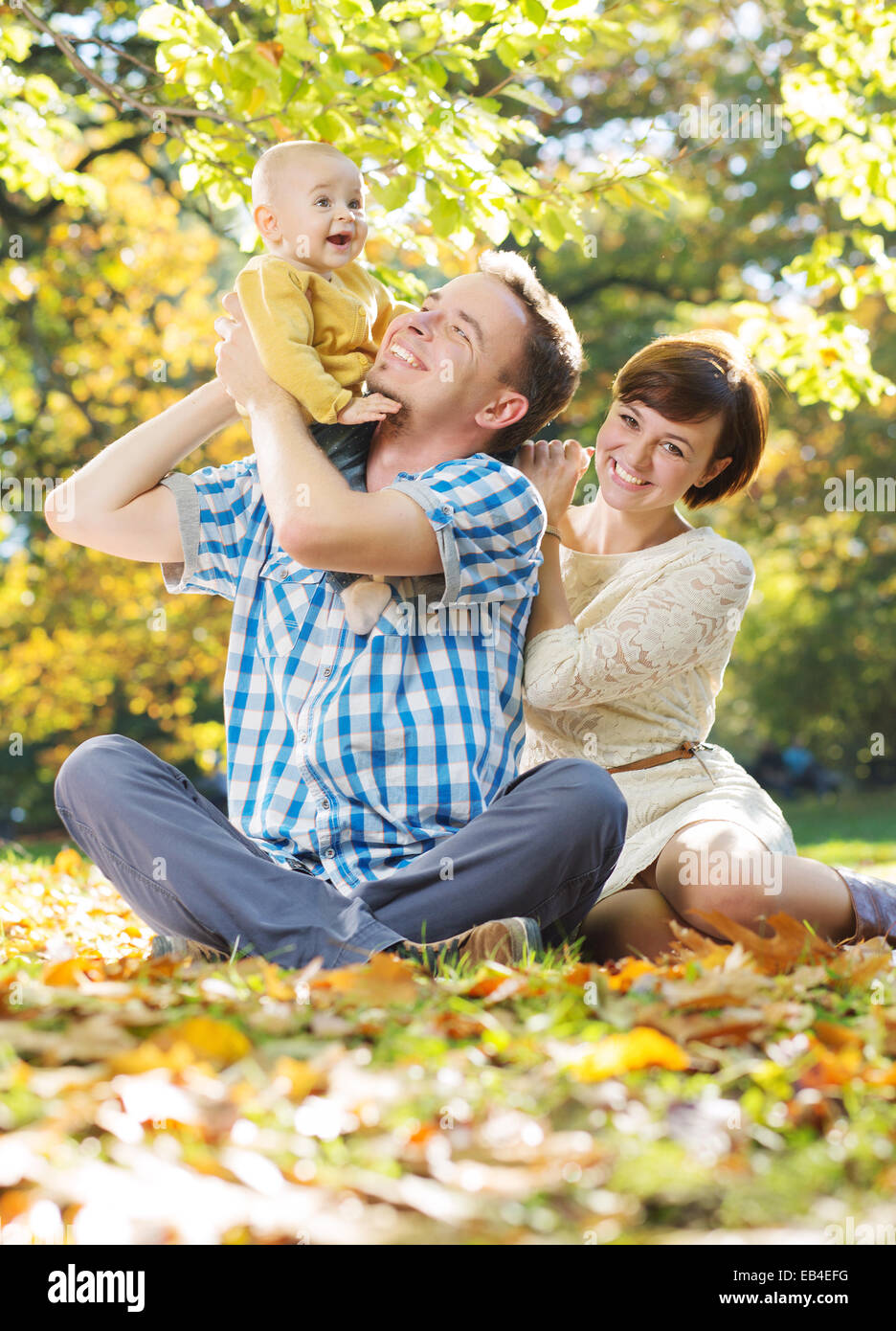 Young parents enjoying spare time with child - Stock Image