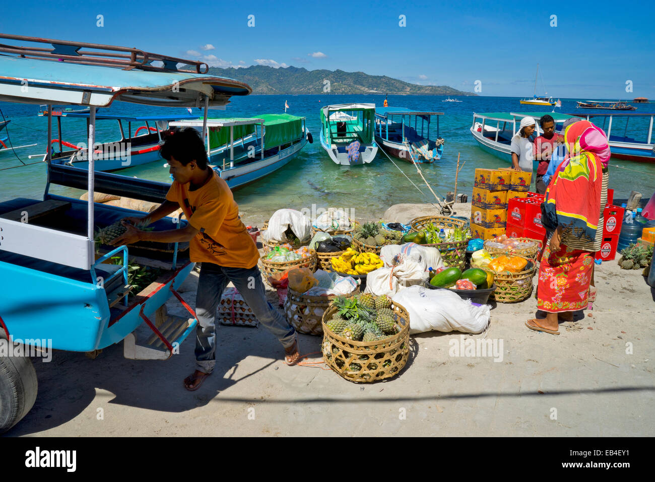 fruit and vegetables sellers at the harbor of Gili Air - Stock Image