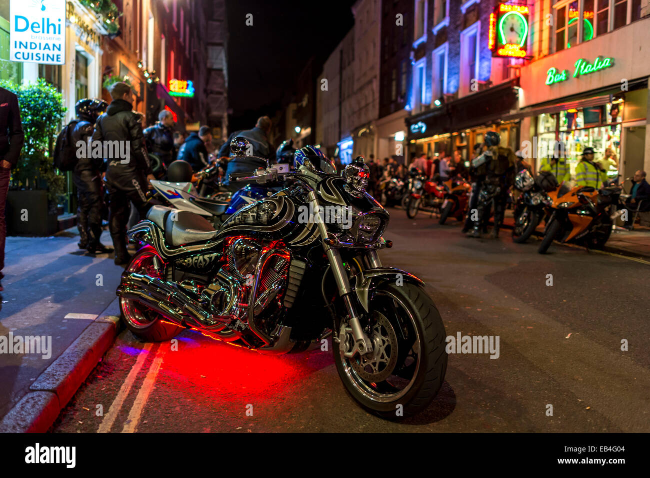 Bikers gather in Soho after midnight with many powerful motorcycles - Stock Image