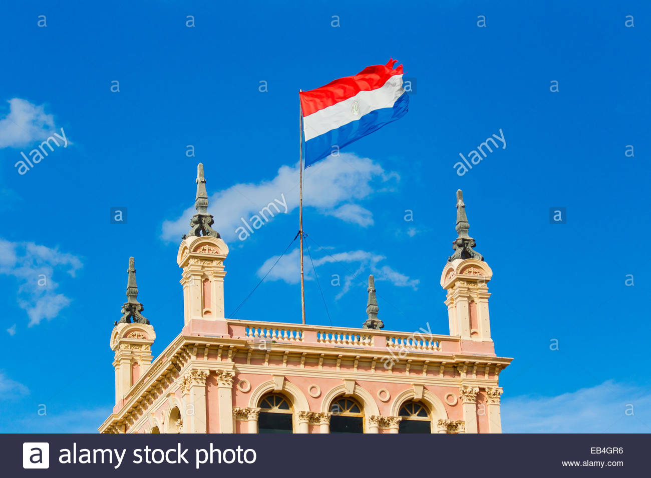 A flag of the Republic of Paraguay flying atop the Presidential palace. - Stock Image