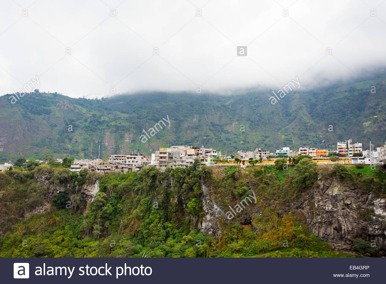 Low-lying clouds over the city of Banos de Agua Santa, at the foot of the Tungurahua volcano. - Stock Image