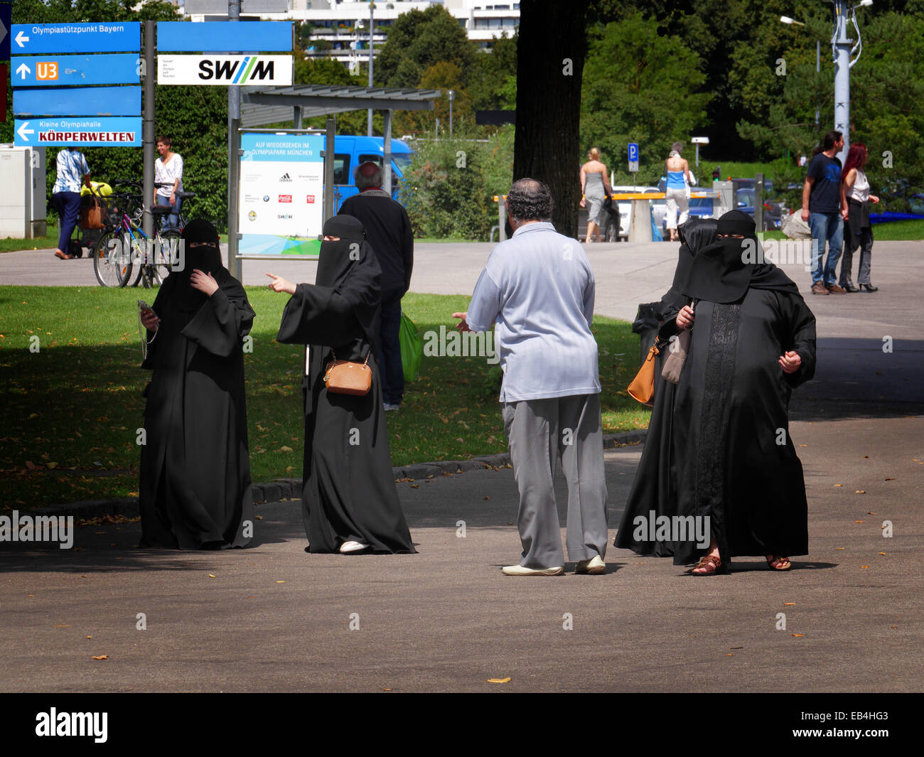 Arab Saudi Arabian Women tourists in traditional black Burka in Olympia Park Munich Germany Europe - Stock Image