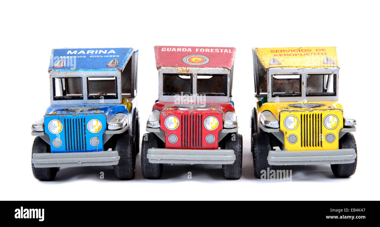 three small offroad cars on the white background - Stock Image