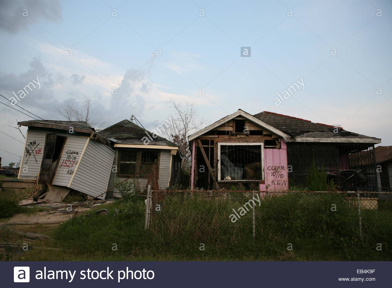 Houses that were damaged by Katrina marked by searchers going through the buildings; the one on the right was being - Stock Image